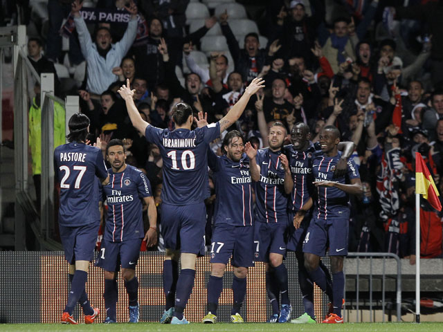 Paris Saint Germain's Zlatan Ibrahimovic, center left no. 10, celebrates a goal with teammates during their French League One soccer match against Lyon in Lyon, central France, Sunday, May 12, 2013. (AP Photo/Laurent Cipriani)