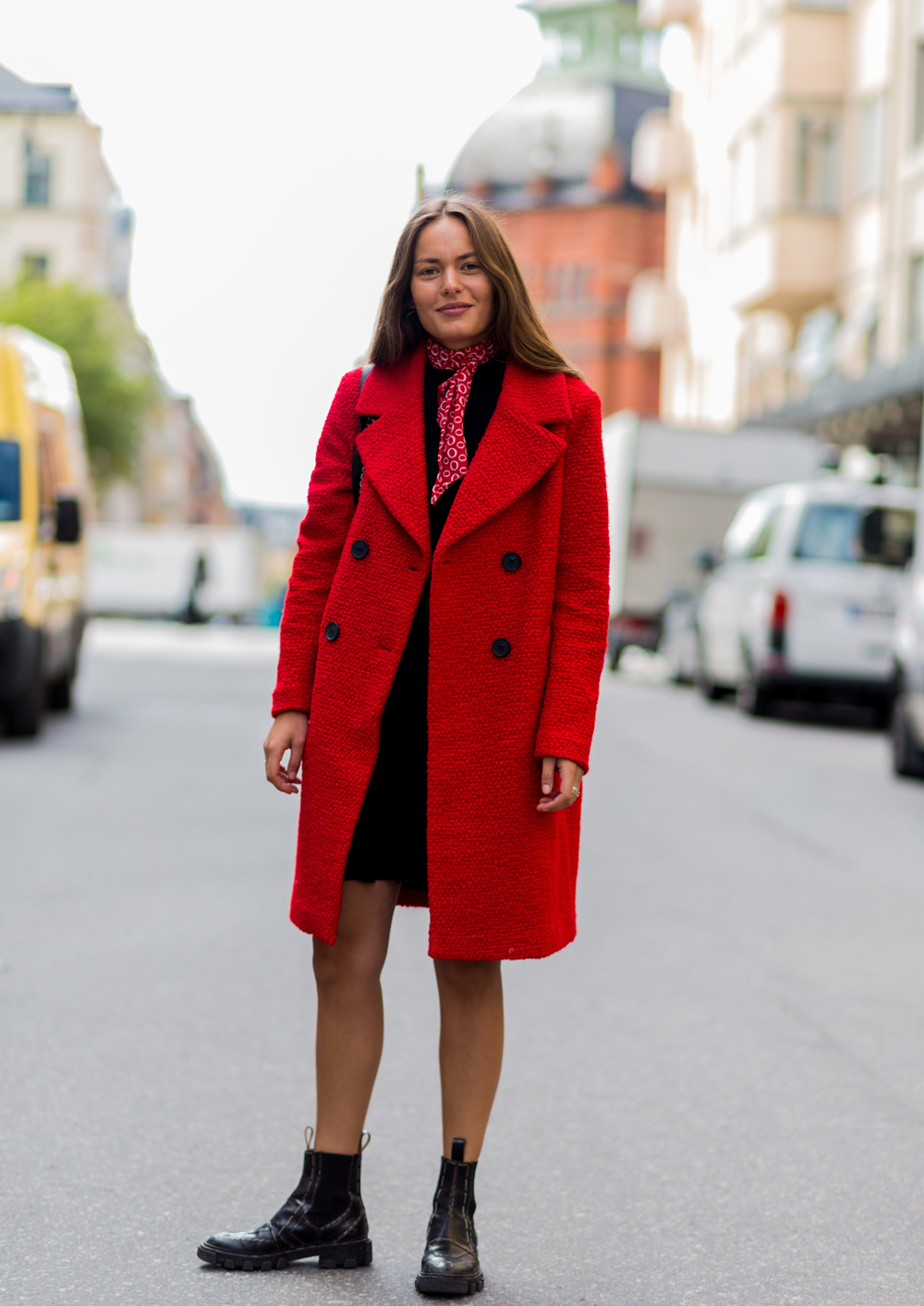 STOCKHOLM, SWEDEN - AUGUST 30: Victoria Saceanu wearing a red coat, black Chelsea boots, a red bandana scarf and black dress outside Lexington during the second day of the Stockholm Fashion Week Spring/Summer 2017 on August 30, 2016 in Stockholm, Sweden. (Photo by Christian Vierig/Getty Images)