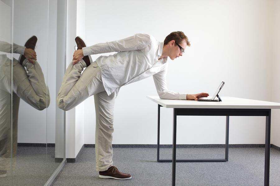 bigstock-leg-exercise-durrng-office-wor-49857992