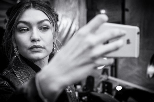 NEW YORK, NY - FEBRUARY 15: (EDITORS NOTE; image has been converted to black and white) Gigi Hadid backstage at the Tommy Hilfiger Women's Fall 2016 show during New York Fashion Week: The Shows at Park Avenue Armory on February 15, 2016 in New York City. (Photo by Grant Lamos IV/Getty Images for Tommy Hilfiger)