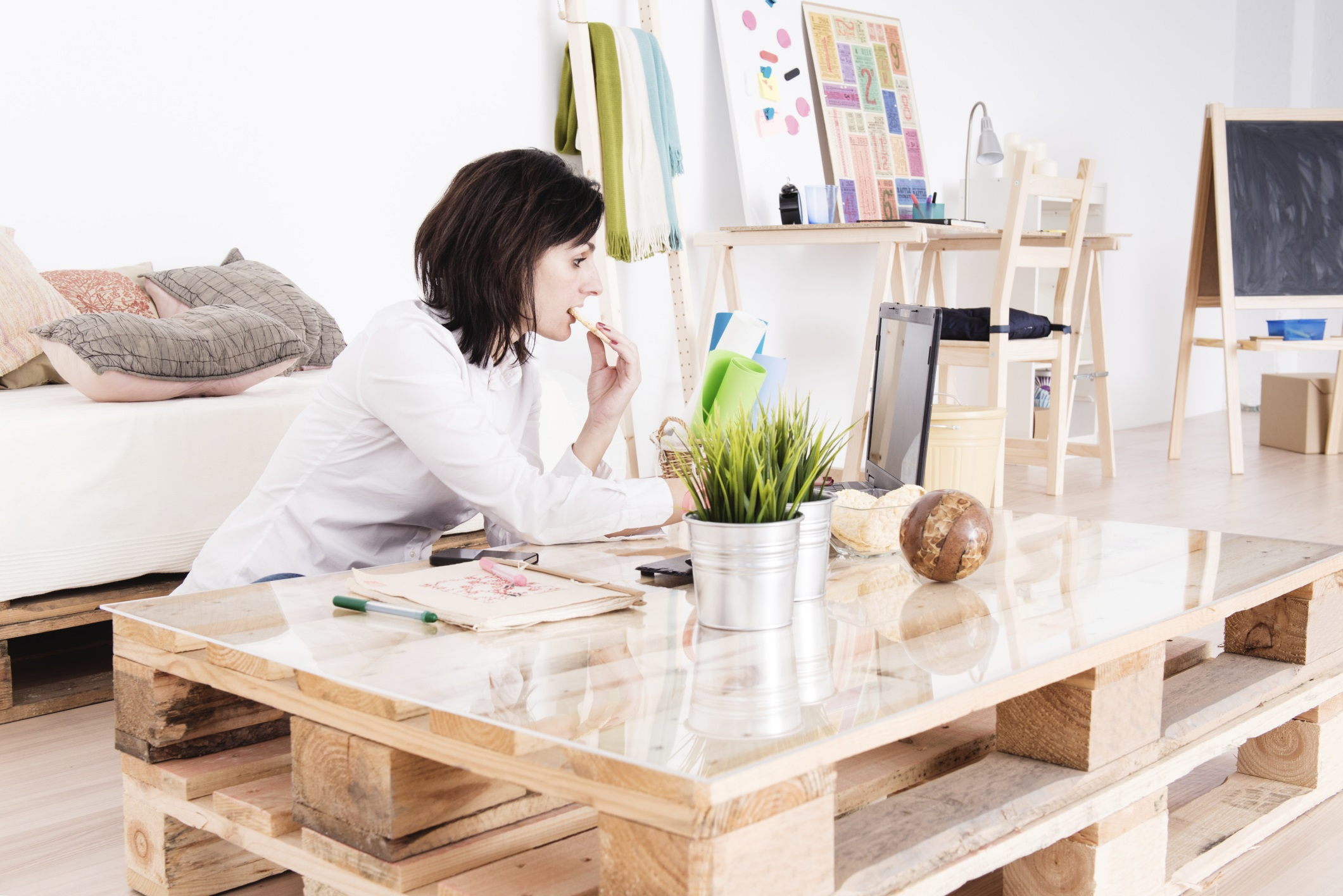 Woman working with her laptop in living room
