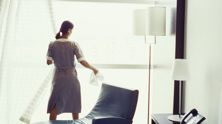 gallery-1435607013-hotel-maids-cleaning-curtains