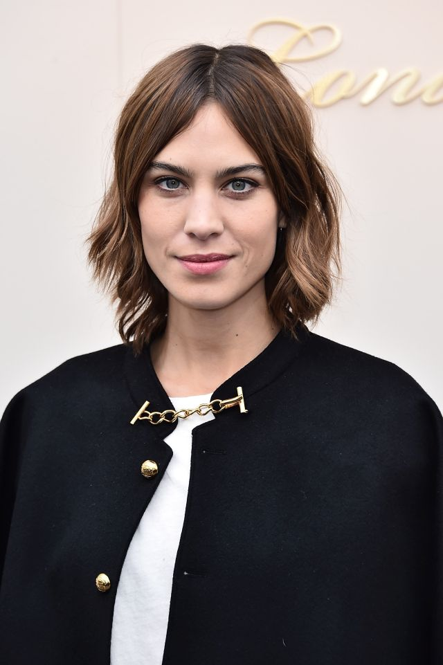 LONDON, ENGLAND - FEBRUARY 22: Alexa Chung wearing Burberry at the Burberry Womenswear February 2016 Show at Kensington Gardens on February 22, 2016 in London, England. (Photo by Gareth Cattermole/Getty Images for Burberry)
