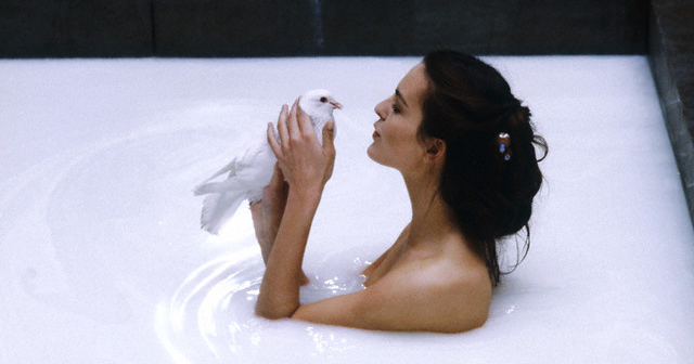 February 1984 --- The French actress Carole Bouquet holds a white bird and baths in milk, during the shooting of the movie Good King Dagobert. --- Image by © Fabian Cevallos/Sygma/Corbis