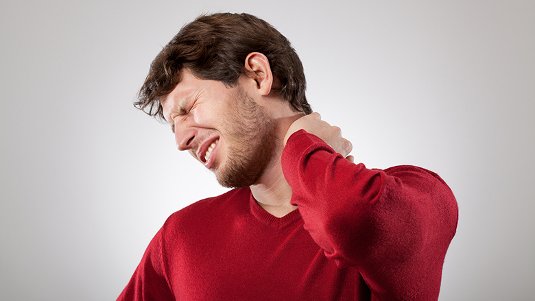 Man isolated has a strong neck pain