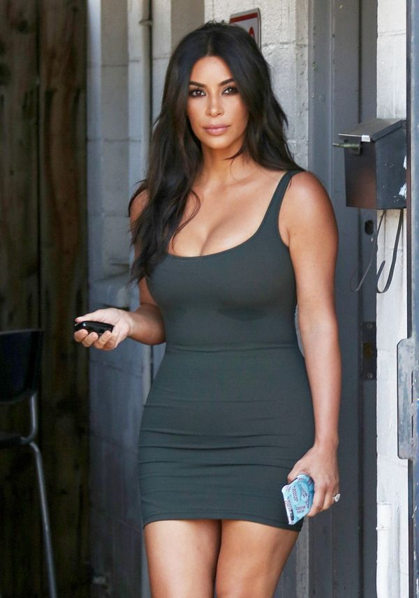 Van Nuys, CA - Kim Kardashian appears to be sweating under her lady lumps as she leaves the Bunim-Muray productions studio in a cleavage baring skin tight green dress and tan heels with a smile. June 21, 2016, Image: 291994302, License: Rights-managed, Restrictions: , Model Release: no, Credit line: Profimedia, AKM-GSI