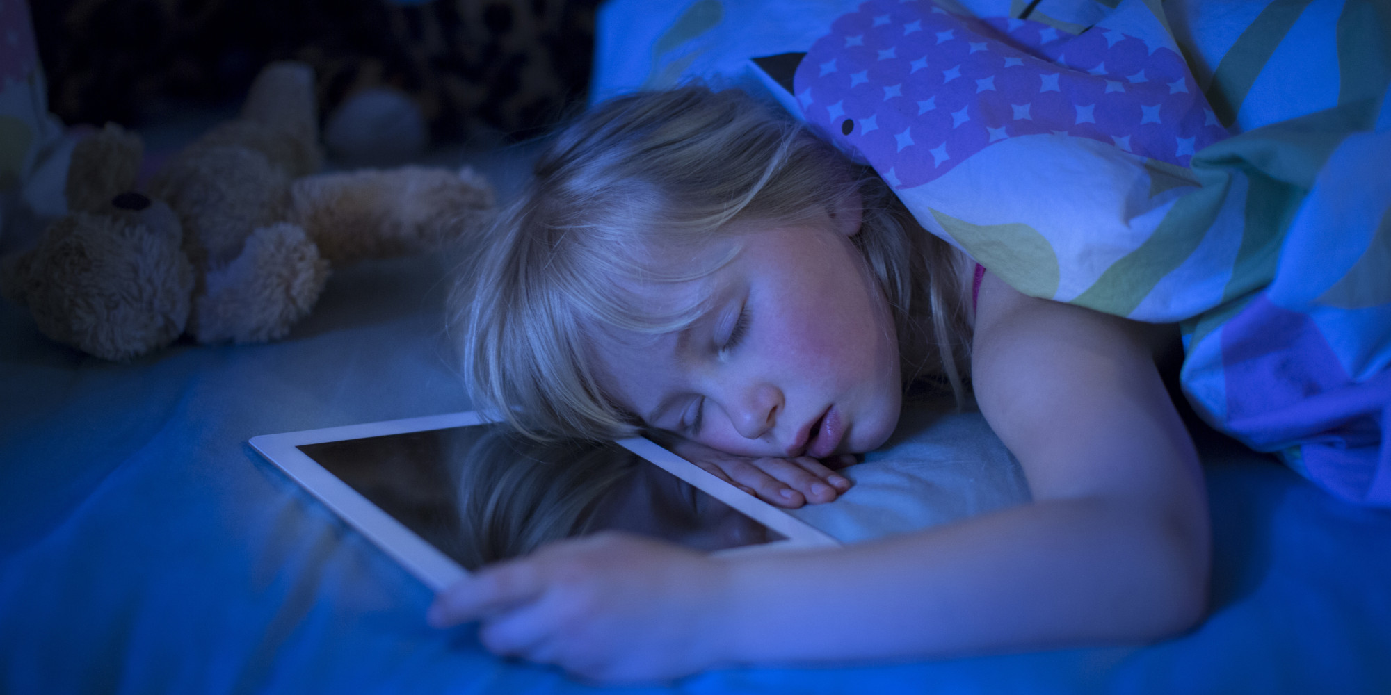 GIRL SLEEPING WITH TABLET COMPUTER