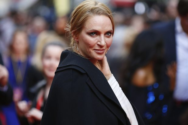 US actress Uma Thurman poses for photographers while arriving for the Premiere of West End musical Charlie and the Chocolate Factory, at the Theatre Royal, in central London on June 25, 2013. AFP PHOTO / JUSTIN TALLIS (Photo credit should read JUSTIN TALLIS/AFP/Getty Images)