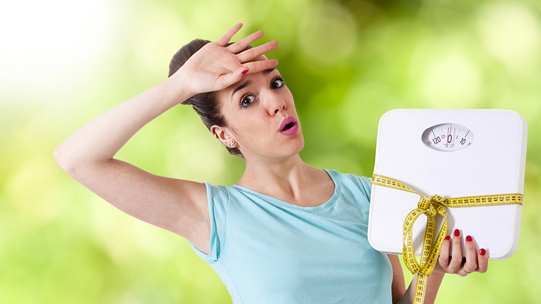 woman with tape measure worried about weight