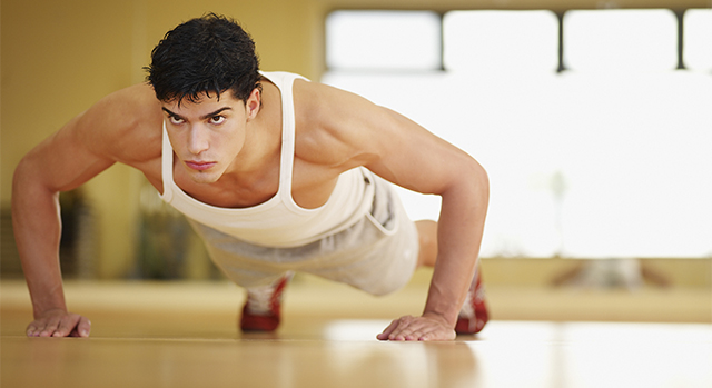 Man doing push-ups in a fitness studio