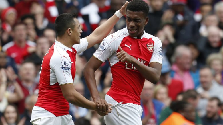 Arsenal's Nigerian striker Alex Iwobi (R) celebrates with Arsenal's Chilean striker Alexis Sanchez after scoring during the English Premier League football match between Arsenal and Watford at the Emirates Stadium in London on April 2, 2016.  / AFP / Ian Kington / RESTRICTED TO EDITORIAL USE. No use with unauthorized audio, video, data, fixture lists, club/league logos or 'live' services. Online in-match use limited to 75 images, no video emulation. No use in betting, games or single club/league/player publications.  /         (Photo credit should read IAN KINGTON/AFP/Getty Images)