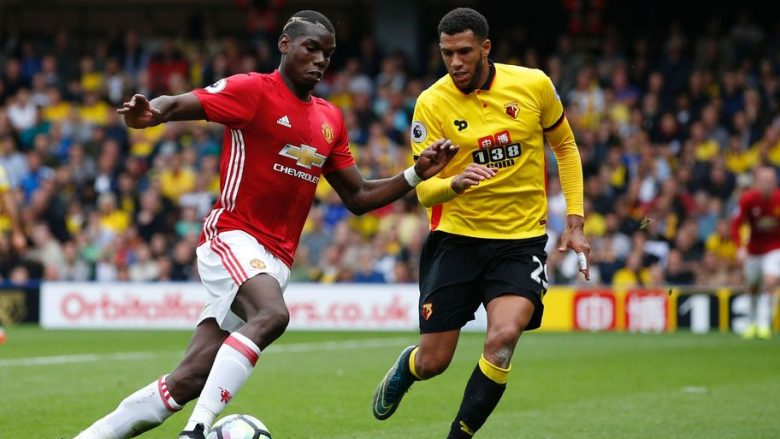 Manchester United's French midfielder Paul Pogba (L) vies with Watford's French midfielder Etienne Capoue during the English Premier League football match between Watford and Manchester United at Vicarage Road Stadium in Watford, north of London on September 18, 2016. / AFP / Adrian DENNIS / RESTRICTED TO EDITORIAL USE. No use with unauthorized audio, video, data, fixture lists, club/league logos or 'live' services. Online in-match use limited to 75 images, no video emulation. No use in betting, games or single club/league/player publications.  /         (Photo credit should read ADRIAN DENNIS/AFP/Getty Images)