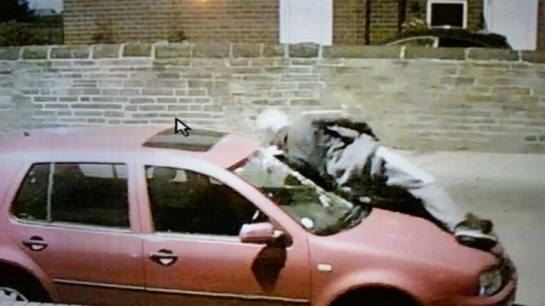 PIC FROM MERCURY PRESS (PICTURED: THE YOB HURLING HIMSELF AT MICHAELA CAMM'S CAR) A vulnerable mum sobbed when she discovered a yob had DELIBERATELY hurled himself at her car and smashed the windscreen as part of a so-called ëbody slammingí craze. Michaela Camm, from Leeds, Yorks, installed CCTV cameras just a week before the incident due to an increase in anti-social behaviour in the Armley area. Michaela, who is recovering from spinal surgery, watched open-mouthed when she saw the footage of a hooded figure launching himself at her red VW Golf. The 23-second footage shows a teen charging the windscreen with his left shoulder and shattering the window before leaping off the bonnet and sprinting away, followed by four pals. SEE MERCURY COPY