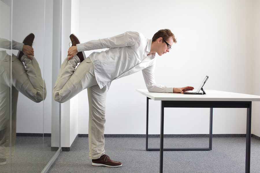 bigstock-leg-exercise-durrng-office-wor-49857992