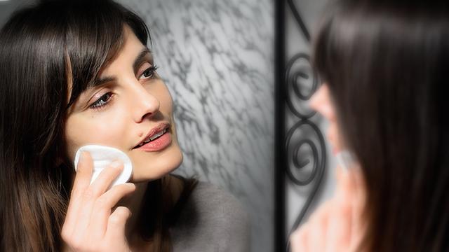 beautiful girl cleansing skin face