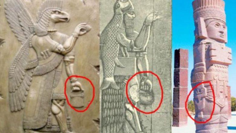Statujat e lashta me çanta misterioze që ngjajnë me ato të ditëve të sotme (Video)