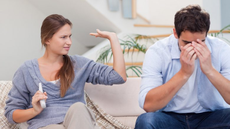 Man being tired of arguing with his wife in their living room; Shutterstock ID 90152665; PO: The Huffington Post; Job: The Huffington Post; Client: The Huffington Post; Other: The Huffington Post