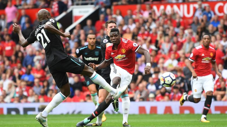 MANCHESTER, ENGLAND - AUGUST 13: Paul Pogba of Manchester United scores his sides fourth goal during the Premier League match between Manchester United and West Ham United at Old Trafford on August 13, 2017 in Manchester, England.  (Photo by Michael Regan/Getty Images)