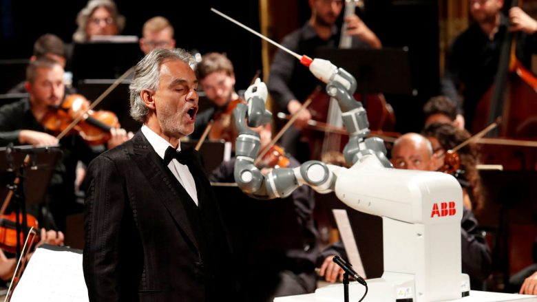 Humanoid robot YuMi conducts the Lucca Philharmonic Orchestra performing a concert alongside Italian tenor Andrea Bocelli at the Verdi Theatre in Pisa, Italy September 12, 2017. REUTERS/Remo Casilli     TPX IMAGES OF THE DAY - RC19496DD210