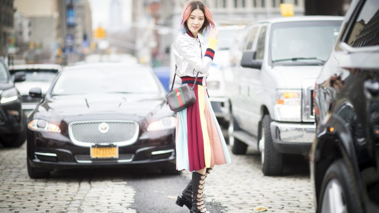 NEW YORK, NY - FEBRUARY 17:  Irene Kim is wearing a coloured skirt and boots from Chanel seen in the streets of Manhattan during New York Fashion Week: Women's Fall/Winter 2016 on February 17, 2016 in New York City.  (Photo by Timur Emek/Getty Images)