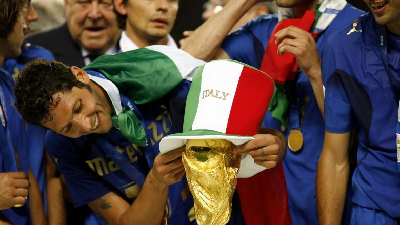 BERLIN - JULY 09:  Marco Materazzi of Italy places an Italian hat onto the world cup trophy during the FIFA World Cup Germany 2006 Final match between Italy and France at the Olympic Stadium on July 9, 2006 in Berlin, Germany.   (Photo by Michael Steele/Getty Images)