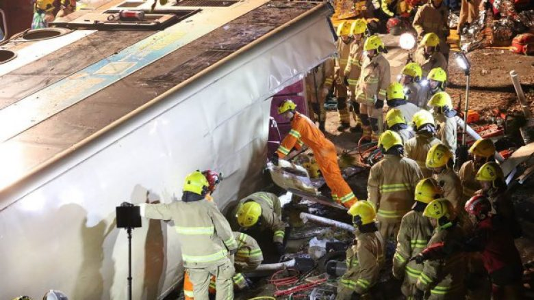 Firefighters and emergency personnel work at the site of an accident after a double-decker bus a toppled over along a road near the town of Tai Po in Hong Kong's northern New Territories on February 10, 2018. At least 19 people were killed and dozens injured when a double-decker bus toppled over in Hong Kong on February 10 evening, police said. / AFP PHOTO / SCMP / --/AFP/Getty Images