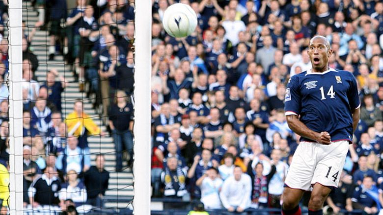 Scotland's Chris Iwelumo on his debut, looks shocked as he watches his shot on an open goal go wide
