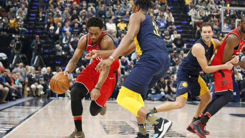 Mar 15, 2018; Indianapolis, IN, USA; Toronto Raptors guard DeMar DeRozan (10) drives to the basket against Indiana Pacers center Myles Turner (33) during the first quarter at Bankers Life Fieldhouse. Mandatory Credit: Brian Spurlock-USA TODAY Sports