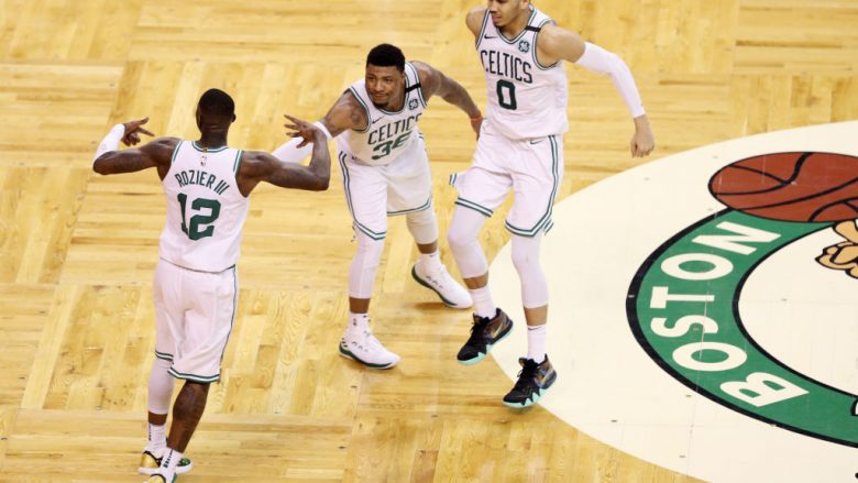 BOSTON, MA - APRIL 28: Terry Rozier #12 of the Boston Celtics, Marcus Smart #36 and Jayson Tatum #0 celebrate during the fourth quarter against the Milwaukee Bucks in Game Seven in Round One of the 2018 NBA Playoffs at TD Garden on April 28, 2018 in Boston, Massachusetts. The Celtics defeat the Bucks 112-96. (Photo by Maddie Meyer/Getty Images)