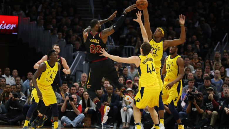 CLEVELAND, OH - APRIL 29: LeBron James #23 of the Cleveland Cavaliers passes around Myles Turner #33 of the Indiana Pacers during the first half in Game Seven of the Eastern Conference Quarterfinals during the 2018 NBA Playoffs at Quicken Loans Arena on April 29, 2018 in Cleveland, Ohio. NOTE TO USER: User expressly acknowledges and agrees that, by downloading and or using this photograph, User is consenting to the terms and conditions of the Getty Images License Agreement. (Photo by Gregory Shamus/Getty Images)