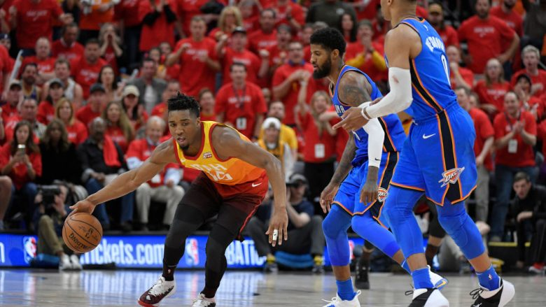 SALT LAKE CITY, UT - APRIL 21: Donovan Mitchell #45 of the Utah Jazz dribbles around Paul George #13 and Russell Westbrook #0 of the Oklahoma City Thunder in the second half during Game Three of Round One of the 2018 NBA Playoffs at Vivint Smart Home Arena on April 21, 2018 in Salt Lake City, Utah. The Jazz beat the Thunder 115-102. NOTE TO USER: User expressly acknowledges and agrees that, by downloading and or using this photograph, User is consenting to the terms and conditions of the Getty Images License Agreement. (Photo by Gene Sweeney Jr./Getty Images)