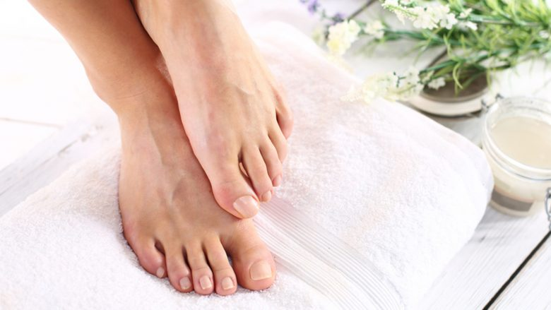 Sugar paste, care of female legs. Beautiful feet of a woman during treatments.; Shutterstock ID 263555975; PO: today.com