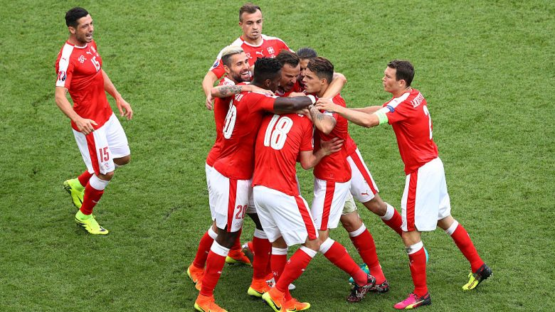 PARIS, FRANCE - JUNE 15: Admir Mehmedi of Switzerland is crowded out by team mates after he scored his teams first goal during the UEFA EURO 2016 Group A match between Romania and Switzerland at Parc des Princes on June 15, 2016 in Paris, France.  (Photo by Paul Gilham/Getty Images)