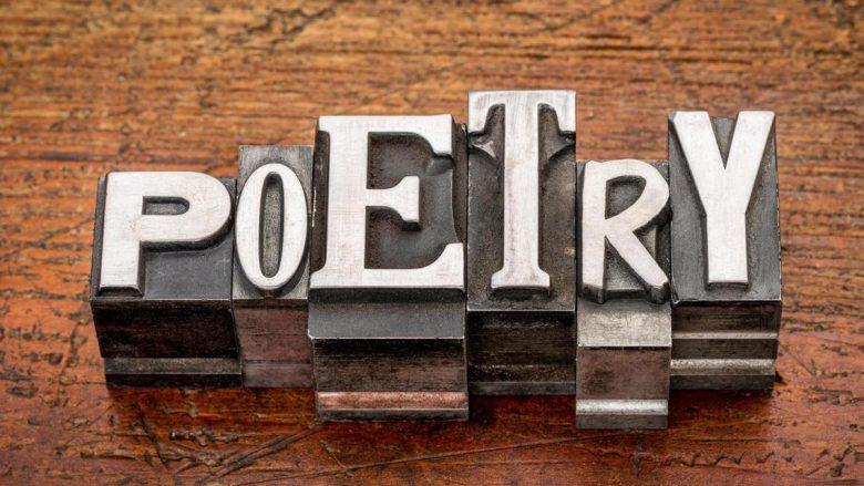 ECRGHN poetry word in mixed vintage metal type printing blocks over grunge wood