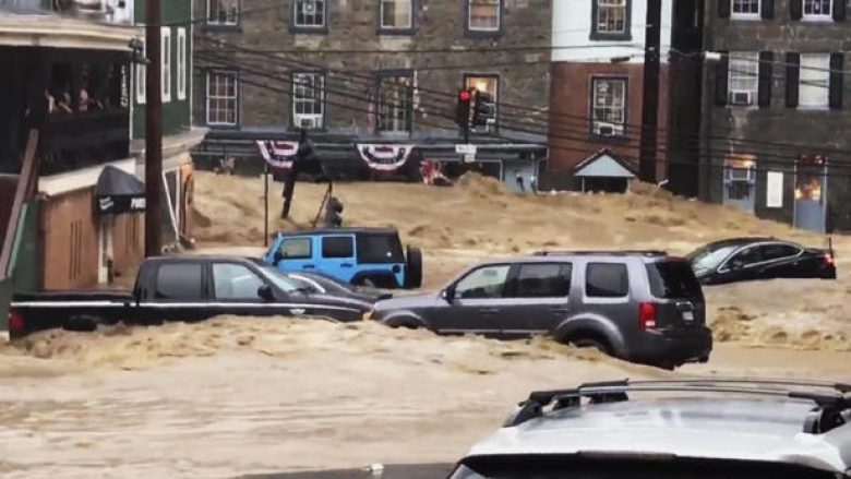 Water rushes through Main Street in Ellicott City, Md., Sunday, May 27, 2018. Flash flooding and water rescues are being reported in Maryland as heavy rain soaks much of the state. (Libby Solomon/The Baltimore Sun via AP)