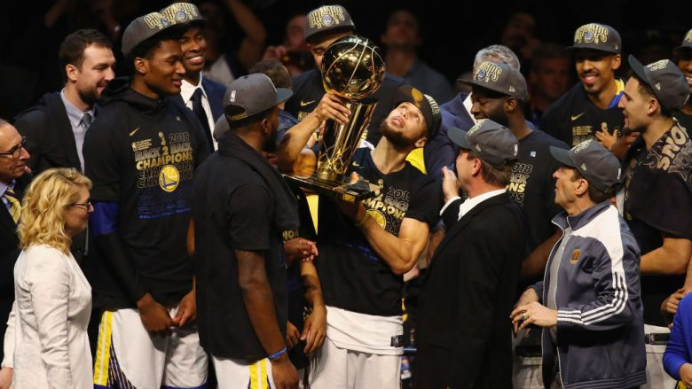 CLEVELAND, OH - JUNE 08: Stephen Curry #30 of the Golden State Warriors celebrates with the Larry O'Brien Trophy after defeating the Cleveland Cavaliers during Game Four of the 2018 NBA Finals at Quicken Loans Arena on June 8, 2018 in Cleveland, Ohio. The Warriors defeated the Cavaliers 108-85 to win the 2018 NBA Finals. NOTE TO USER: User expressly acknowledges and agrees that, by downloading and or using this photograph, User is consenting to the terms and conditions of the Getty Images License Agreement.  (Photo by Justin K. Aller/Getty Images)