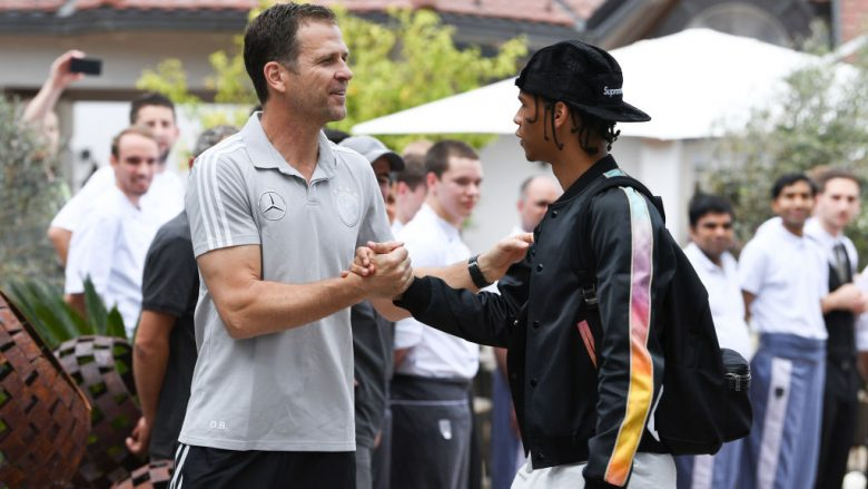 EPPAN, ITALY - MAY 23:  Team Manager, Olivier Bierhoff greets Leroy Sane as he arrives on day one of the Germany National Football team's training camp at Hotel Weinegg on May 23, 2018 in Eppan, Italy. (Photo by Markus Gilliar/DFB - Pool/Getty Images)