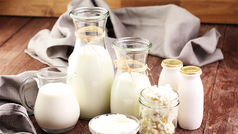 milk products - tasty healthy dairy products on a table on: sour cream in a white bowl cottage cheese bowl cream in a a bank and milk jar glass bottle and in a glass