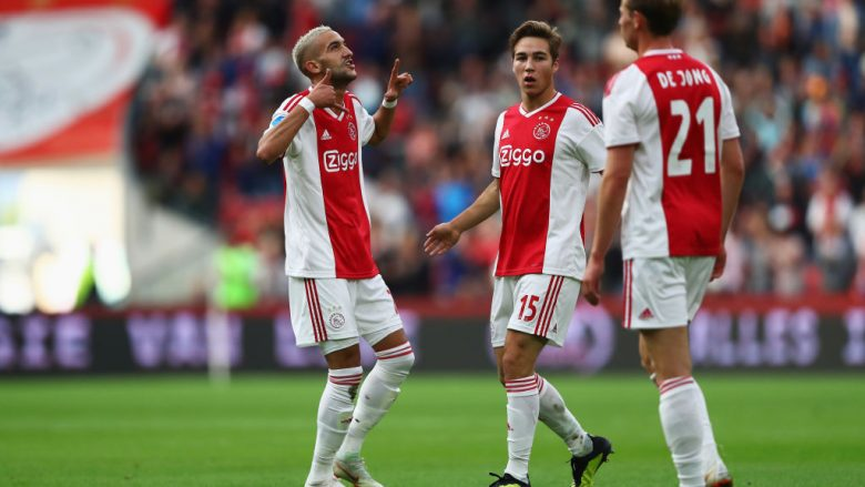 AMSTERDAM, NETHERLANDS - AUGUST 25:  Hakim Ziyech of Ajax celebrates scoring his teams first goal of the game with team mates Carel Eiting and Frenkie de Jong during the Eredivisie match between Ajax and Emmen at Johan Cruyff Arena on August 25, 2018 in Amsterdam, Netherlands.  (Photo by Dean Mouhtaropoulos/Getty Images)