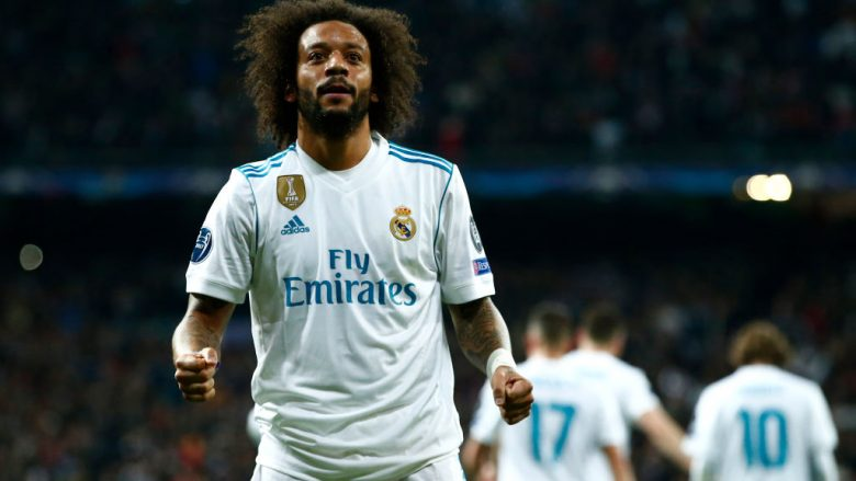 MADRID, SPAIN - FEBRUARY 14:  Marcelo of Real Madrid celebrates scoring the 3rd Real Madrid goal during the UEFA Champions League Round of 16 First Leg match between Real Madrid and Paris Saint-Germain at Bernabeu on February 14, 2018 in Madrid, Spain.  (Photo by Gonzalo Arroyo Moreno/Getty Images)