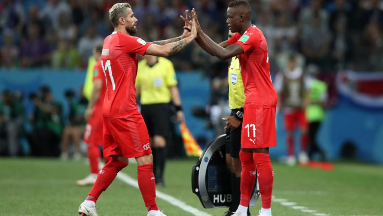 NIZHNY NOVGOROD, RUSSIA - JUNE 27:  Valon Behrami of Switzerland greets Denis Zakaria of Switzerland as Valon Behrami is substituted off and Denis Zakaria is subtituted on during the 2018 FIFA World Cup Russia group E match between Switzerland and Costa Rica at Nizhny Novgorod Stadium on June 27, 2018 in Nizhny Novgorod, Russia.  (Photo by Clive Brunskill/Getty Images)