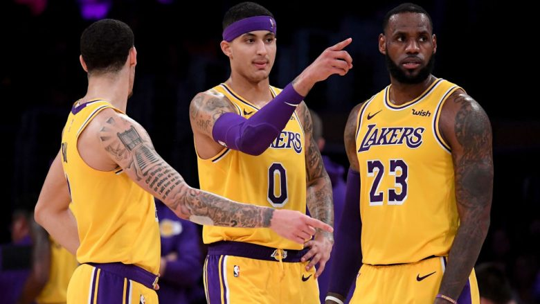 LOS ANGELES, CA - NOVEMBER 29:  LeBron James #23, Kyle Kuzma #0 and Kyle Lonzo Ball #2 of the Los Angeles Lakers talk during a 104-96 win over the Indiana Pacers at Staples Center on November 29, 2018 in Los Angeles, California.  NOTE TO USER: User expressly acknowledges and agrees that, by downloading and or using this photograph, User is consenting to the terms and conditions of the Getty Images License Agreement.  (Photo by Harry How/Getty Images)