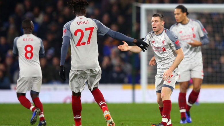BURNLEY, ENGLAND - DECEMBER 05:  James Milner of Liverpool celebrates with team mate Divock Origi of Liverpool after scoring their team's first goal during the Premier League match between Burnley FC and Liverpool FC at Turf Moor on December 5, 2018 in Burnley, United Kingdom.  (Photo by Alex Livesey/Getty Images)