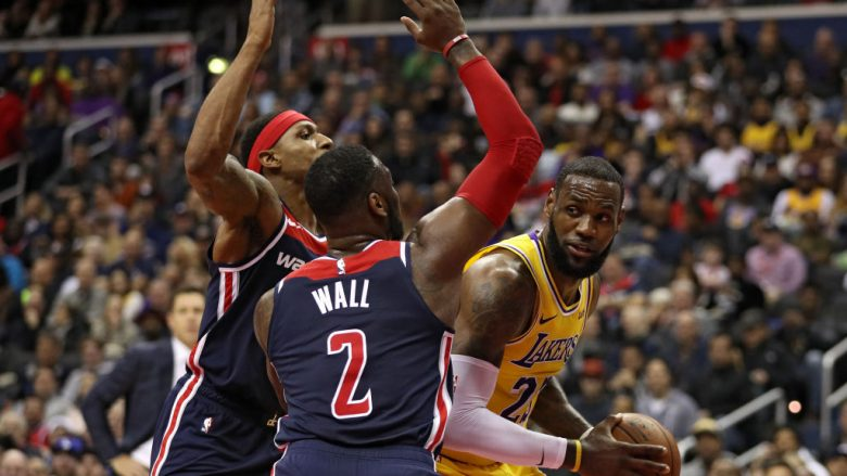 WASHINGTON, DC - DECEMBER 16: LeBron James #23 of the Los Angeles Lakers is defended by John Wall #2 of the Washington Wizards during the first half at Capital One Arena on December 16, 2018 in Washington, DC. NOTE TO USER: User expressly acknowledges and agrees that, by downloading and or using this photograph, User is consenting to the terms and conditions of the Getty Images License Agreement. (Photo by Patrick Smith/Getty Images)