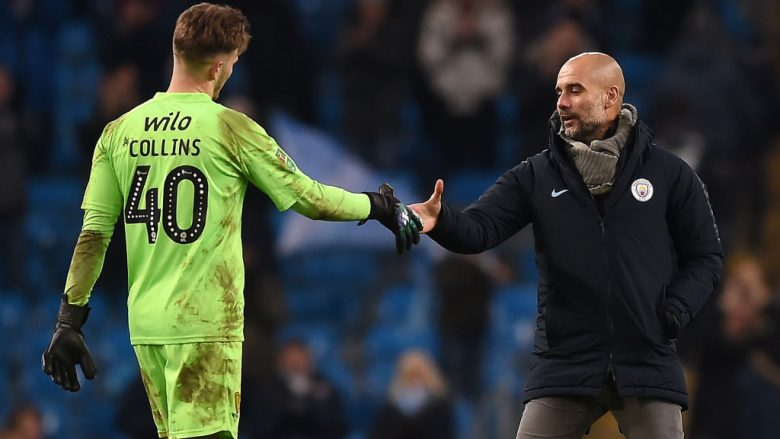 MANCHESTER, ENGLAND - JANUARY 09:  Josep Guardiola, Manager of Manchester City consoles Bradley Collins of Burton Albion after the Carabao Cup Semi Final First Leg match between Manchester City and Burton Albion at Etihad Stadium on January 9, 2019 in Manchester, United Kingdom.  (Photo by Michael Regan/Getty Images)
