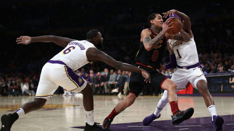 LOS ANGELES, CA - JANUARY 13:  Jordan Clarkson #8 of the Cleveland Cavaliers splits the defense of Kentavious Caldwell-Pope #1 and Lance Stephenson #6 of the Los Angeles Lakers during the second half of a game at Staples Center on January 13, 2019 in Los Angeles, California.  NOTE TO USER: User expressly acknowledges and agrees that, by downloading and or using this photograph, User is consenting to the terms and conditions of the Getty Images License Agreement.  (Photo by Sean M. Haffey/Getty Images)