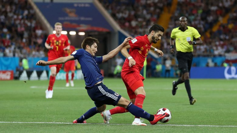 ROSTOV-ON-DON, RUSSIA - JULY 02:  Genki Haraguchi of Japan tackles Yannick Carrasco of Belgium during the 2018 FIFA World Cup Russia Round of 16 match between Belgium and Japan at Rostov Arena on July 2, 2018 in Rostov-on-Don, Russia.  (Photo by Catherine Ivill/Getty Images)
