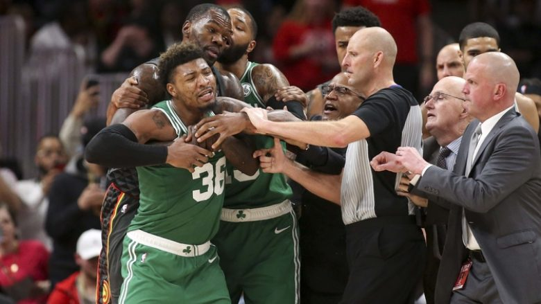 Jan 19, 2019; Atlanta, GA, USA; Boston Celtics guard Marcus Smart (36) is restrained after an ejection against the Atlanta Hawks in the third quarter at State Farm Arena. Mandatory Credit: Brett Davis-USA TODAY Sports