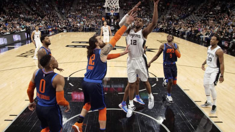 Jan 10, 2019; San Antonio, TX, USA; San Antonio Spurs power forward LaMarcus Aldridge (12) shoots the ball as Oklahoma City Thunder center Steven Adams (12) defends during the first half at AT&T Center. Mandatory Credit: Soobum Im-USA TODAY Sports