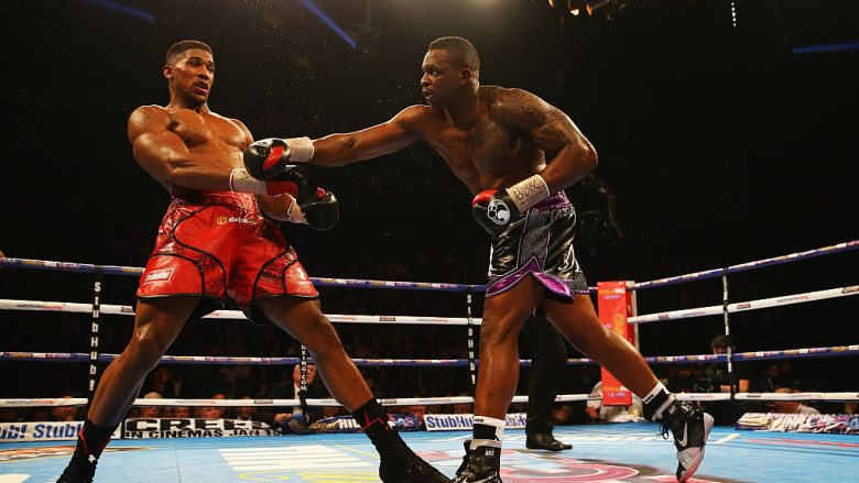 Anthony Joshua (L) and Dillian Whyte in action during the British and Commonwealth heavyweight title contest at The O2 Arena on December 12, 2015 in London, England.  (Photo by Richard Heathcote/Getty Images)